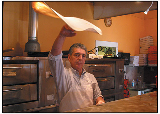 Paul tossing freshly made pizza dough
